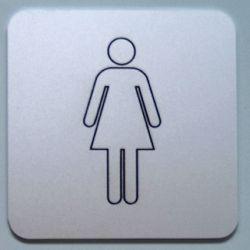 Toalett/garderobeskilt med infreset symbol fyllt med maling.